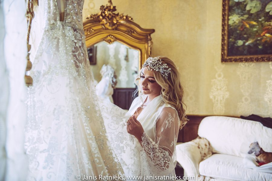 bride admiring Galia Lahav wedding dress