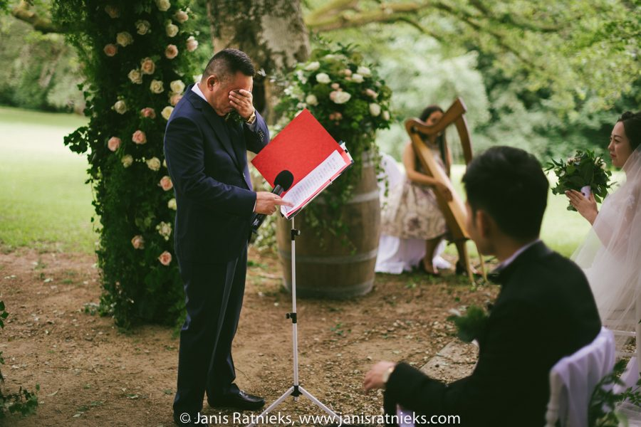 father crying chinese wedding ceremony