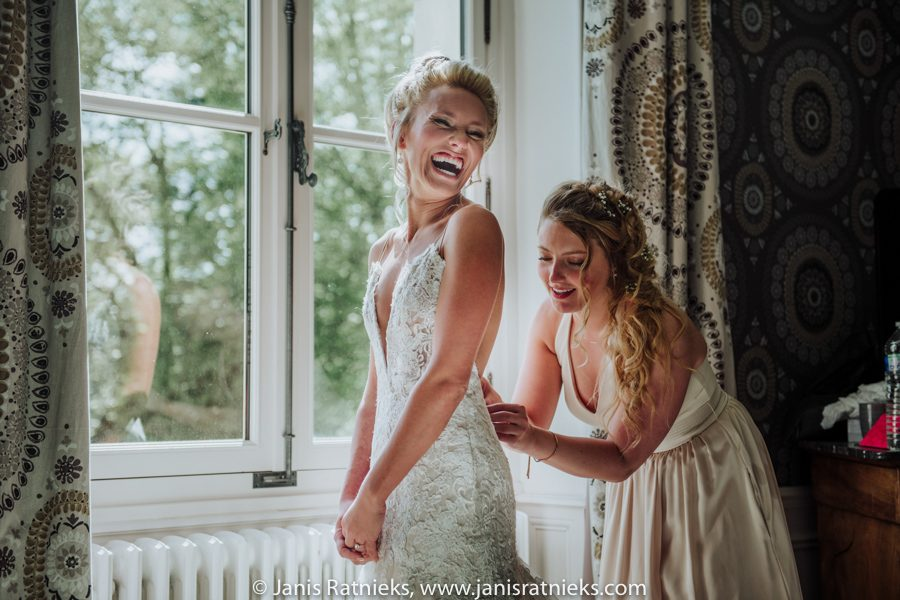 bride getting into the dress