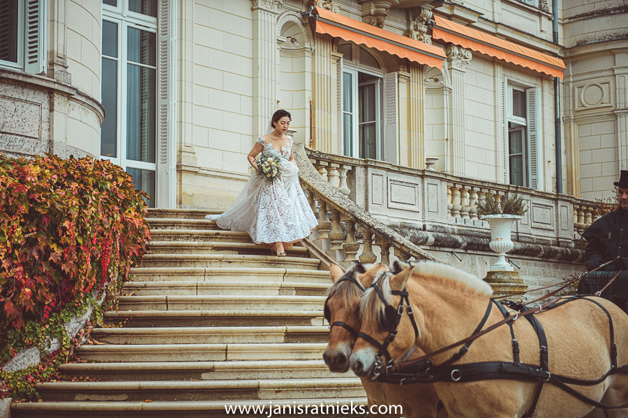 Bride on the stairs of chateau