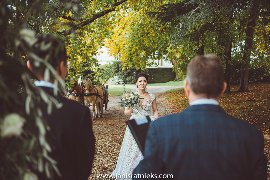 Bride approaching the groom during wedding ceremony