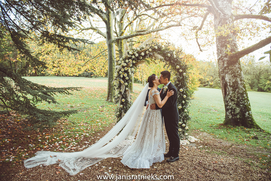 Wedding photo of a groom and bride while kissing
