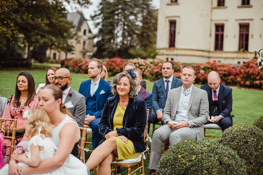 an outdoor wedding in a French chateau