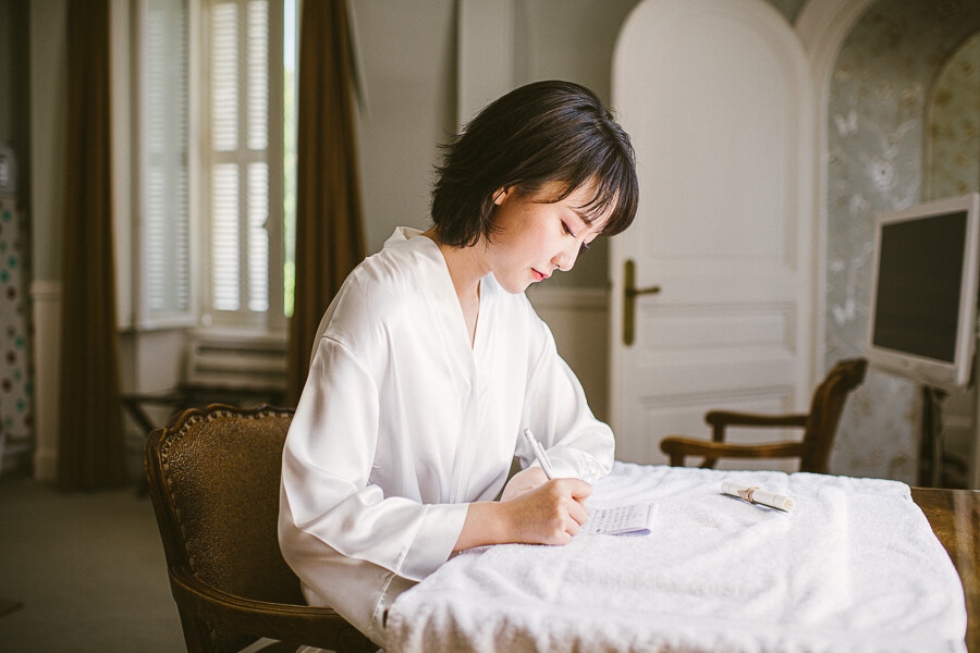Bride writing the love letter to her soon to be husband Chao